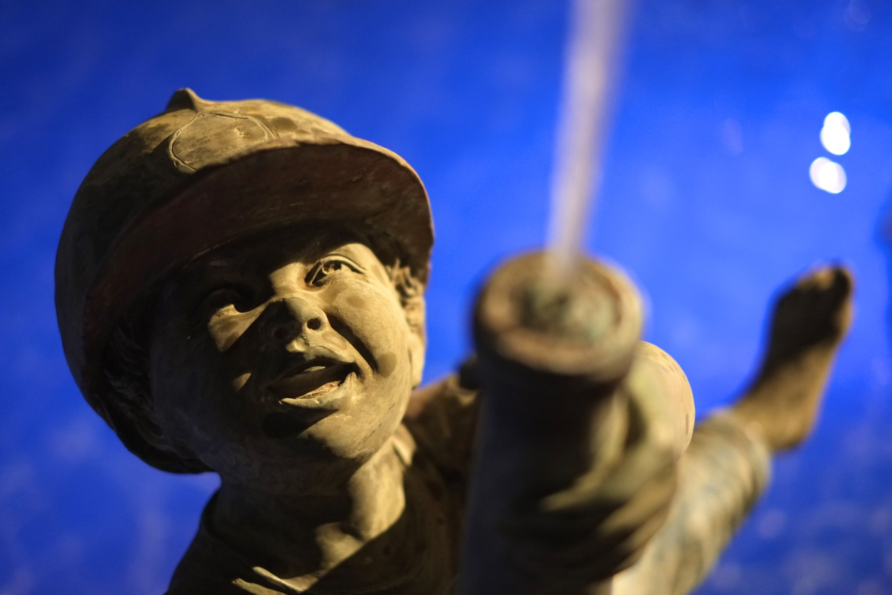 statue of a boy with firehose