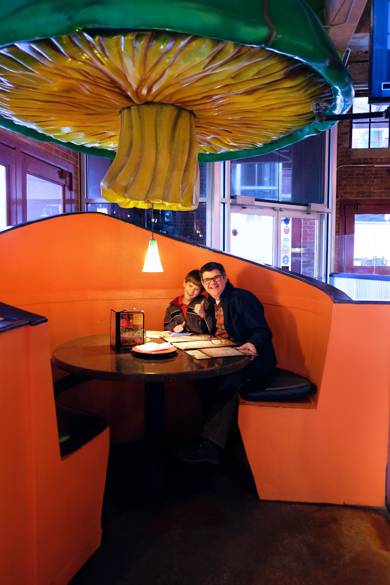 photo of a father and son in the Mellow Mushroom 'Mushroom Booth'