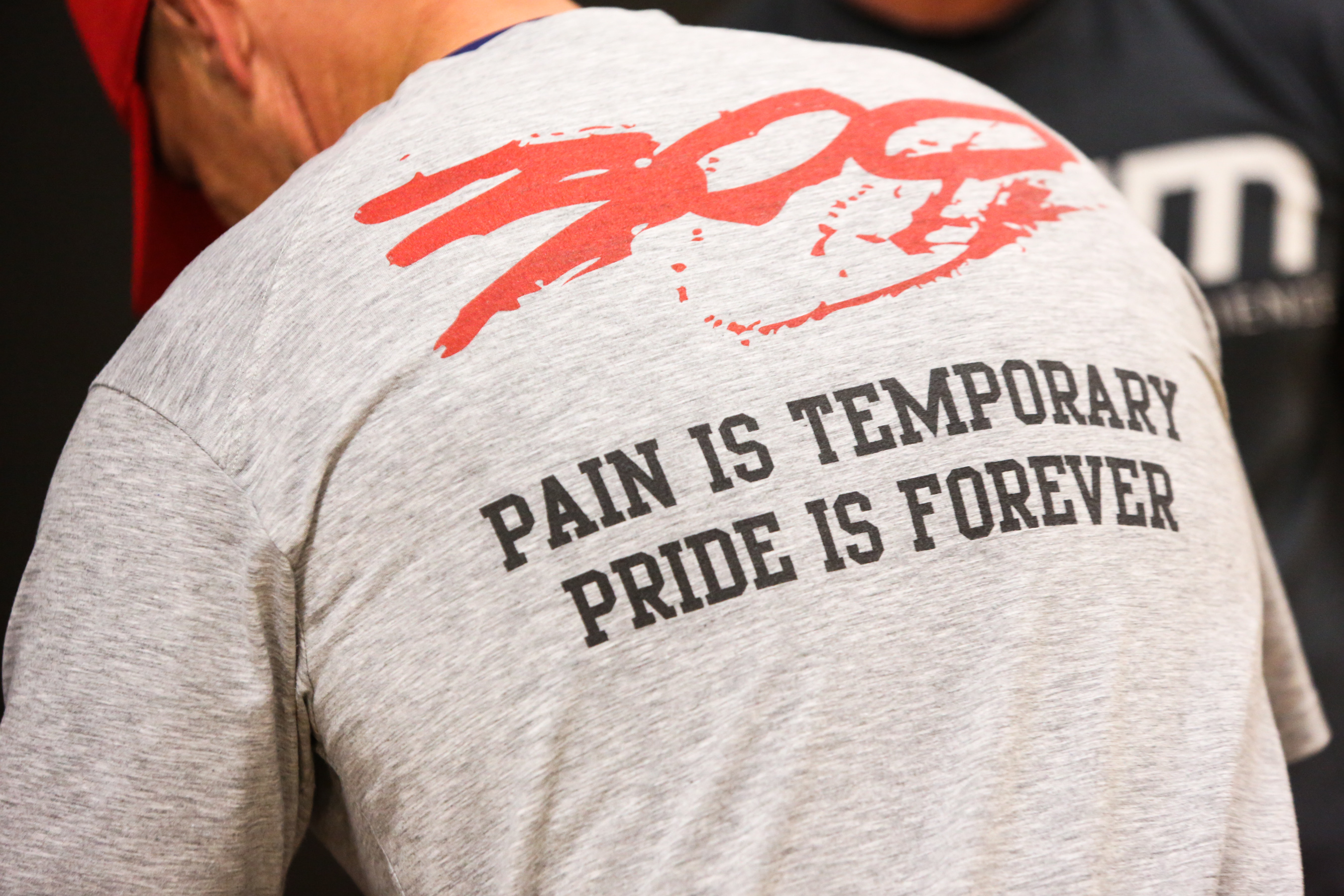 back of shirt that says 'Pain is Temporary, Pride is Forever'