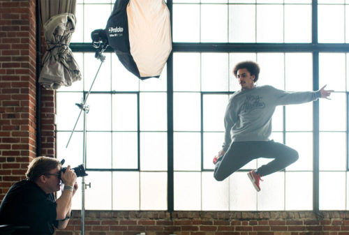 Photo of a Creative Live Class with photographer using a studio light to capture a dancer in the air