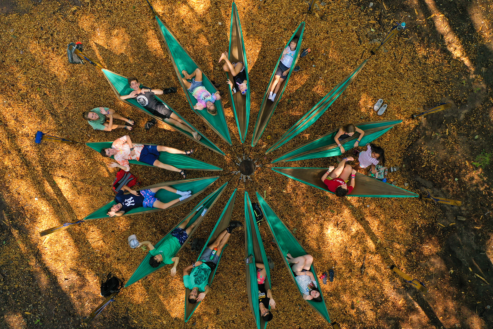 image of kids in a circle of hammocks at a YMCA camp