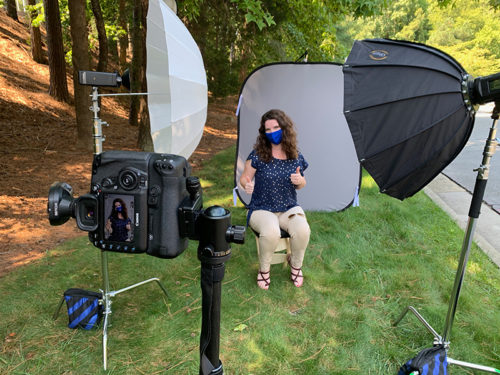 image of COVID masked woman in a safe photo portrait setup outside